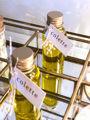Afbeeldingen van PVC flesje gouden dop
